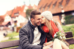Beautiful couple kissing on a date in the city Stock Images