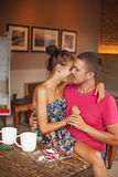 Beautiful couple kissing at home Stock Image