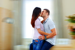 Beautiful couple kissing at home. Portrait of a beautiful couple kissing at home Stock Photography