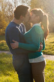 Beautiful couple kissing in the Park Stock Images