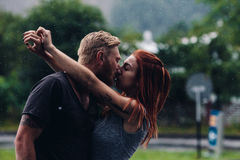 Beautiful couple kissing in the rain Royalty Free Stock Photo