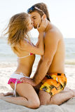 Beautiful couple kissing on the seaside Stock Photo
