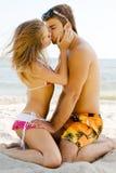 Beautiful couple kissing on the seaside. Beautiful couple kissing on the sea shore Stock Photo