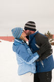 Beautiful couple kissing in the snow. Royalty Free Stock Photos