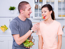 Beautiful couple in the kitchen Royalty Free Stock Image