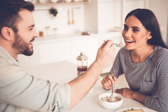 Beautiful couple in kitchen Royalty Free Stock Photography