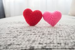 Free Beautiful Couple Knitted Fabric Heart Shape On Fabric Sofa. Stock Photo - 110689350