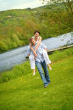 Beautiful couple on a lake Royalty Free Stock Photo