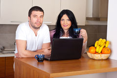 Beautiful couple with laptop and coffee Stock Image