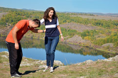 Beautiful couple laughing outdoor. Beautiful couple laughing on a lake background stock images