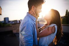 Beautiful couple in love dating outdoors and smiling. Beautiful young couple in love dating outdoors and smiling royalty free stock images