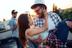 Beautiful couple in love dating outdoors and smiling. Beautiful young couple in love dating outdoors and smiling stock image