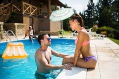 Beautiful couple in love enjoying summer resort Stock Images