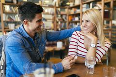 Beautiful couple in love flirting in cafe. And bonding Royalty Free Stock Photos