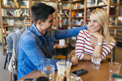 Beautiful couple in love flirting in cafe Stock Photos