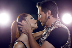 Beautiful couple in love flirting. The girl wants to kiss a guy. Royalty Free Stock Photos
