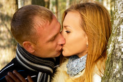 Beautiful couple in love in the forest nature Stock Photos