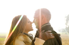 Beautiful couple in love in the forest nature kiss Stock Photo