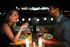Beautiful couple in love having romantic dinner at night. On rooftop Royalty Free Stock Photos