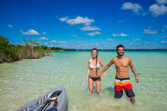 Beautiful couple in love kayaking at tranquil Bacalar lake. Rivi Stock Images