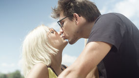 Beautiful couple in love kissing during sunny day. Royalty Free Stock Images
