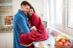 Beautiful couple in love in kitchen royalty free stock photos