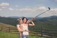 Beautiful couple in love making selfie. Over mountain panorama Stock Photos