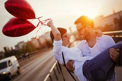 Beautiful couple in love at sunset hugging and dating Stock Photos