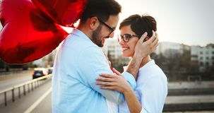 Beautiful couple in love at sunset hugging and dating. Outdoor Stock Photo
