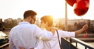Beautiful couple in love at sunset hugging and dating. Outdoor Royalty Free Stock Image