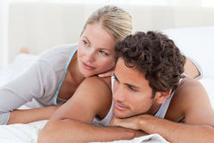 Beautiful couple lying down on their bed Stock Photography
