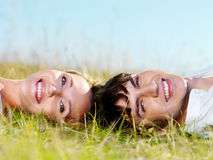 Beautiful couple lying on the grass Stock Photography