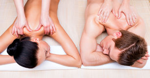 Beautiful couple lying  in a spa salon. Royalty Free Stock Photography