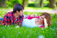 Beautiful couple lying in spring grass Royalty Free Stock Image