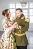 Beautiful couple man and woman in historical costumes stock photo