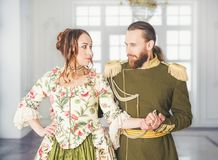 Beautiful couple man and woman in historical costumes royalty free stock image