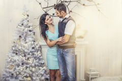 Beautiful couple man and woman hugging in the Christmas interior Royalty Free Stock Photography