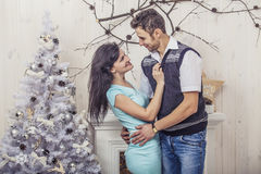 Beautiful couple man and woman hugging in the Christmas interior Stock Images