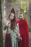 Beautiful couple man and woman in medieval costume. Beautiful couple men and women in medieval costume outdoor stock images