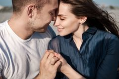 Young Couple Enjoying Beach Holiday royalty free stock images