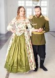 Beautiful couple man and woman in historical costumes royalty free stock photo