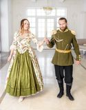 Beautiful couple man and woman in historical costumes royalty free stock photos