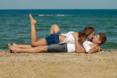 Young couple loving & kissing on the sea side Royalty Free Stock Photo