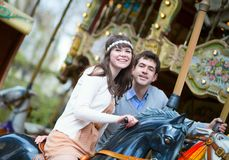 Couple on a merry-go-round Royalty Free Stock Photography