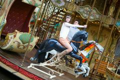 Beautiful couple on a merry-go-round Royalty Free Stock Photo