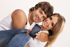 Beautiful couple with a mobile phone Royalty Free Stock Image