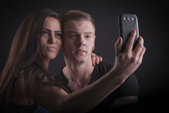 Beautiful couple with mobile phone Royalty Free Stock Images