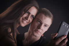 Beautiful couple with mobile phone Stock Image
