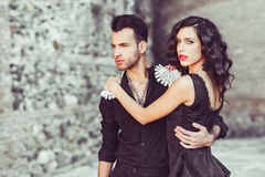 Beautiful couple, models of fashion, wearing spani Royalty Free Stock Photos