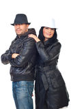 Beautiful couple of models in leather jackets. And hats isolated on white background Royalty Free Stock Photos